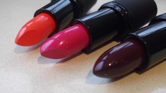 Sleek MakeUP True Colour Lipsticks in Tangerine Scream (orange). Loved Up (pink) and Smother (cassis)