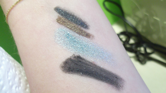 MAC Pigment in Magic Spells, Lucky In Love, and Pearlglide Intense Eyeliners in Lord It Up and Black Swan